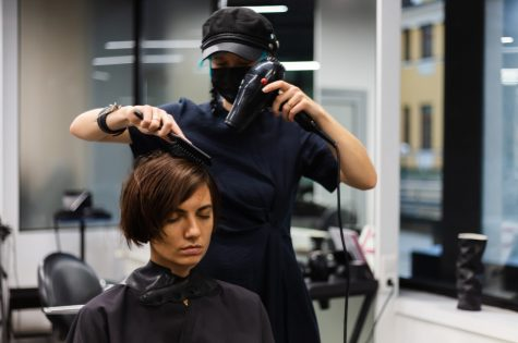professional-girl-hairdresser-makes-client-haircut-girl-is-sitting-mask-beauty-salon